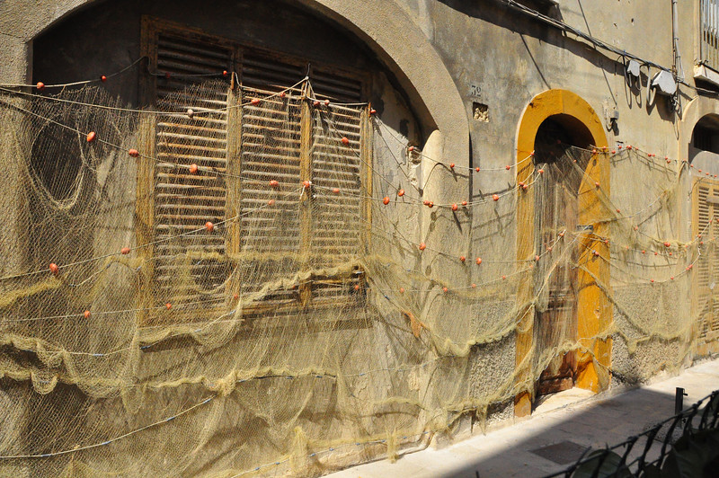 fishnet hung out to dry in Monopoli street