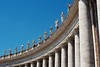 Bernini's massive colonnades, topped by sculptures of saints, surrounding St. Peter's Square