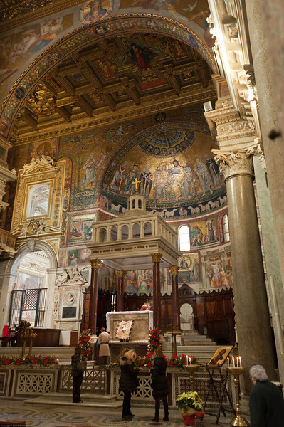 Santa Maria in Trastevere. This is where I lit a candle for my Grandma Berta (next to the Jesus painting on the lower right)