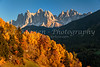 The Dolomite moutain range with fall foliage color near San Pietro, Val di Funes, South Tyrol, Italy, Europe.