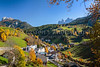 The village of San Pietro with fall foliage color in Val di Funes, South Tyrol, Italy, Europe.