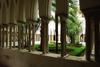The Cloister of Paradise The interlaced arches, supported by 120 slender columns in the Moorish style, the greenery of the small Mediterranean garden in the center of the Cloister.