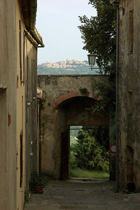 From inside the walls looking out the Porta del Triano gate with Montepulciano in the distance.