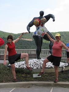 jennifer & sundie posing w/mosaic statue