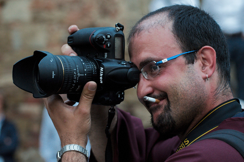 Italian photographer following the procession