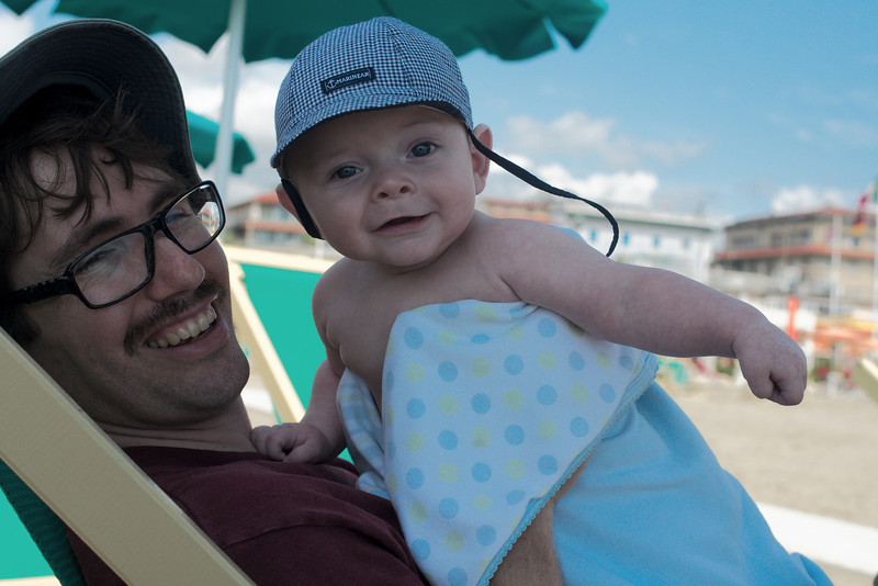 Laurier enjoying his first beach experience with Yann