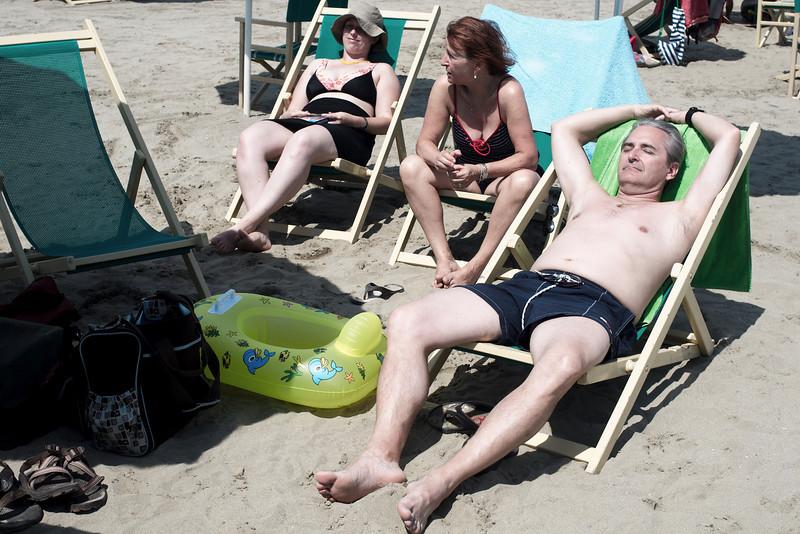 Nicole, Mario and Emilie sun-bathing in Viareggio