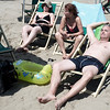 Nicole, Mario and Emilie sun-bathing in Viareggio