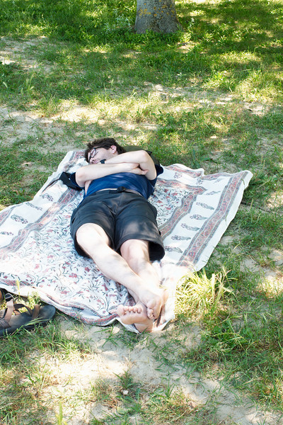 Yann naps on the shore of Lake Trasimeno