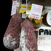 Salami hangs outside a Gubbio store front