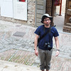 Yann stands on the steps of the Gubbio Cathedral, with Palazzo Ducale in the back ground