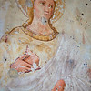 Fading fresco in a Montefalco church.