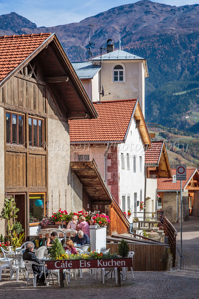 An outdoor restaurant Cafe Eis Kuchen in the village of Glurns Glorenza in Italy, Europe.