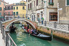 Gondolas and boats in a small canal in Veneto, Venice, Italy, Europe.