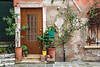 The front door entrance to a rustic building along a small ancal in Veneto, Venice, Italy, Europe.