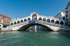The Rialto Bridge and the Grand Canal of Venice, Italy with Venetian architecture, boats and gondolas.