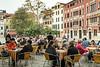 A canalside outdoor restaurant in Veneto, Venice, Italy, Europe.