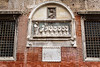 Religious symbols on the exterior walls of a church in Veneto, Venice, Italy, Europe.
