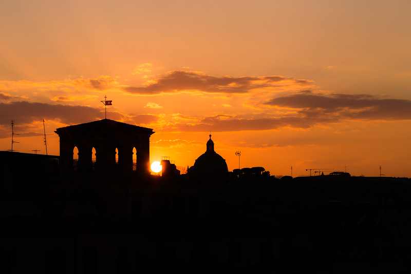 Sunset silhouettes in Rome, Italy.
