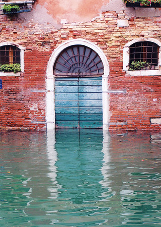 Turquoise door reflection, Venice, Italy