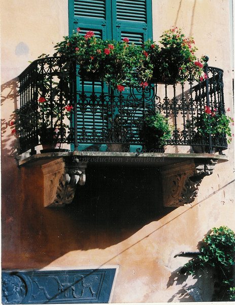 Italian balcony & green shutters red geraniums