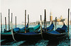 """Venetian Gondolas with Venice in the Background"""