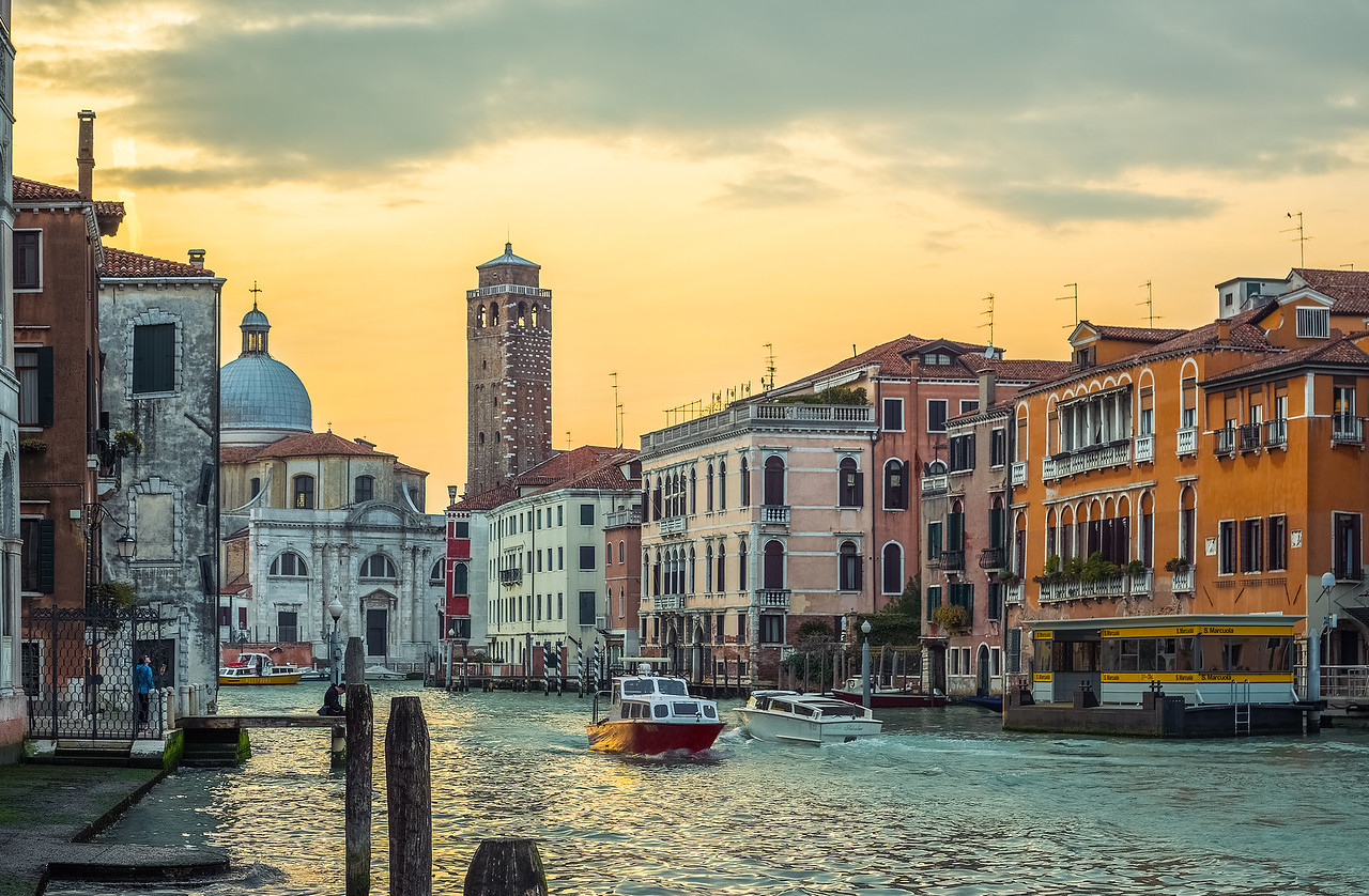Watching boats pass on the waterways of Venice Italy.