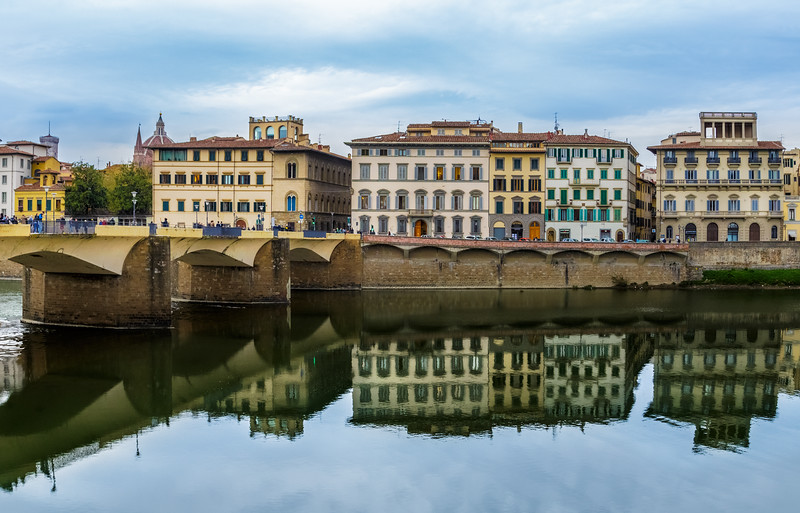 View of the reflections on the Arno River in Florence Italy.