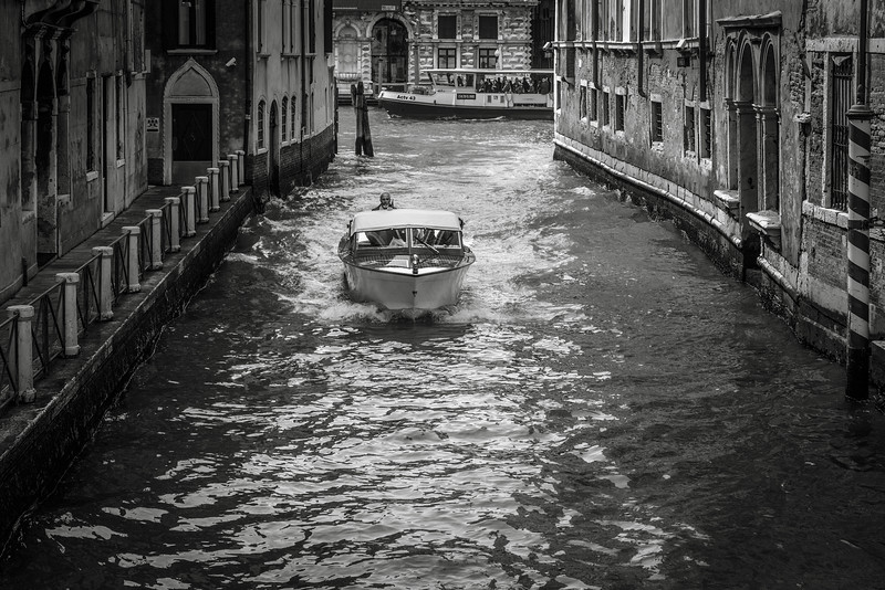 The main mode of transportation in Venice is boats like the one pictured.