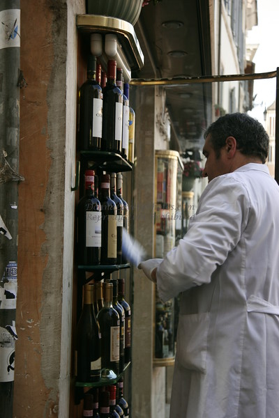 Roman Wine Seller Cleaning the Display, Italy