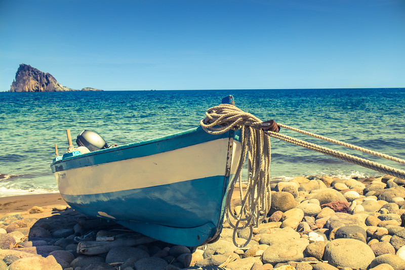 A boat on the shore in Panarea, Italy