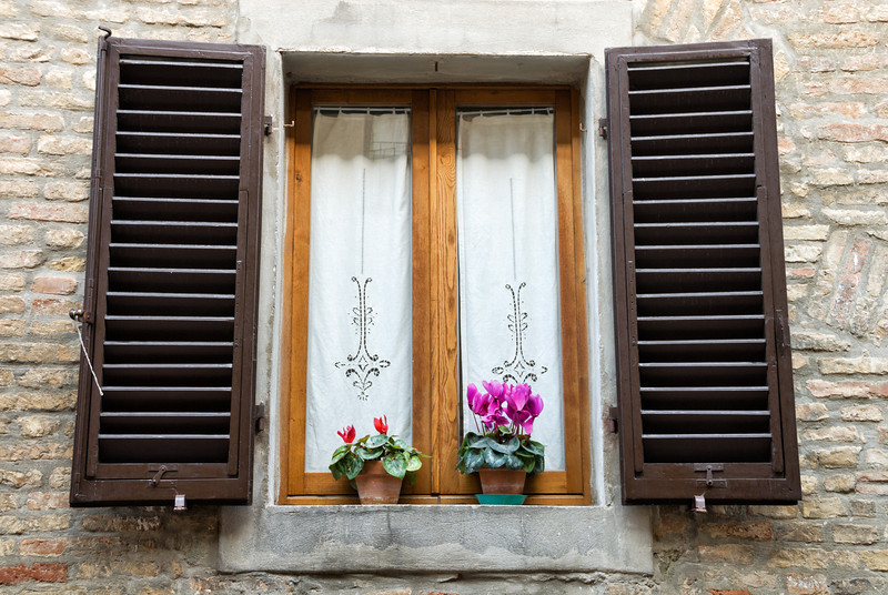 Italian window with lace and flowers