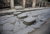 Street stepping stones.  Notice chariot tracks running between the stones.  Pompeii, Italy.
