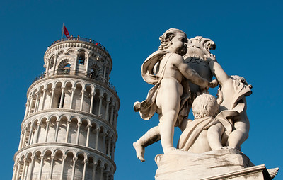 Statue in front of Leaning Tower of Pisa