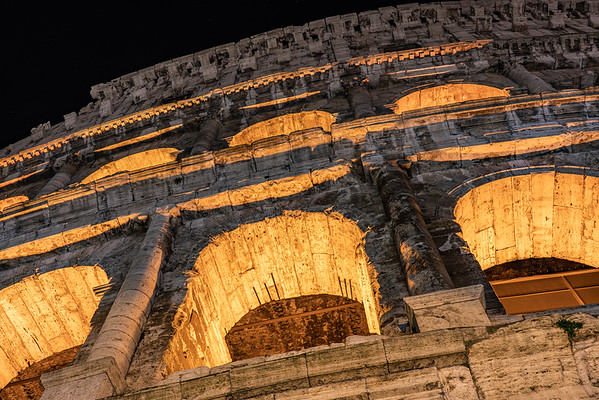 Looking up, the Colosseum