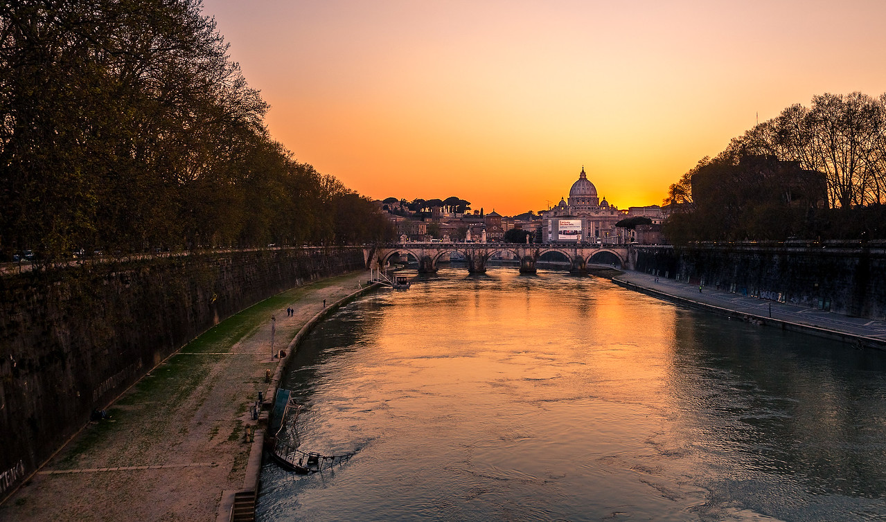 Looking down the River Tiber at the Vatican at sunset.