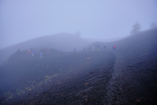 walking the rim of a crater on Etna's north flank