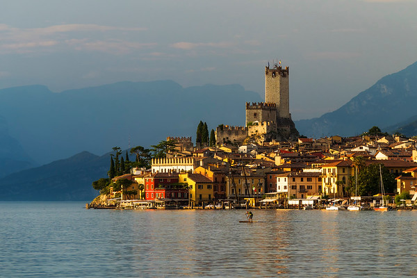 City Malcesine at sunrise with stand up paddle in front