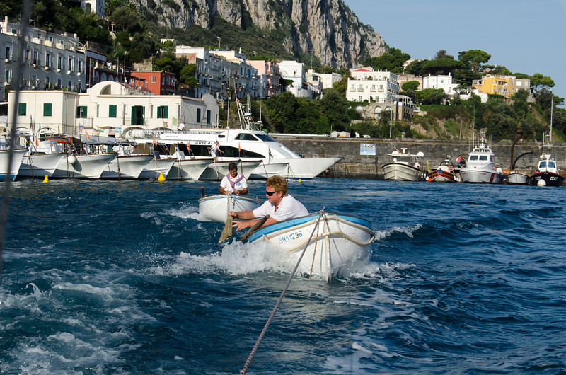 Leaving Marina Grande - The first boats leaving each morning to go to the Blue Grotto tow a couple of really small row boats that actually take the tourist into the Grotto.