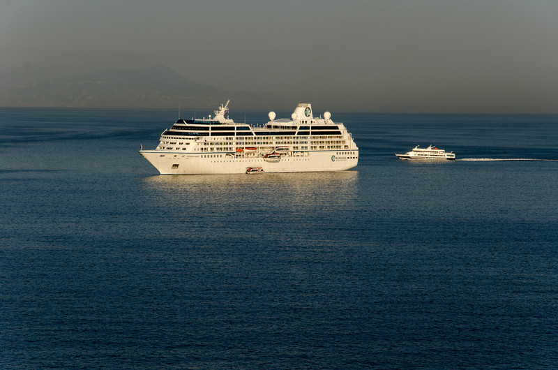 During the tourist season, cruise ships arrive daily to spend the day in Sorrento. If you look closely behind the ship, you can see Capri.