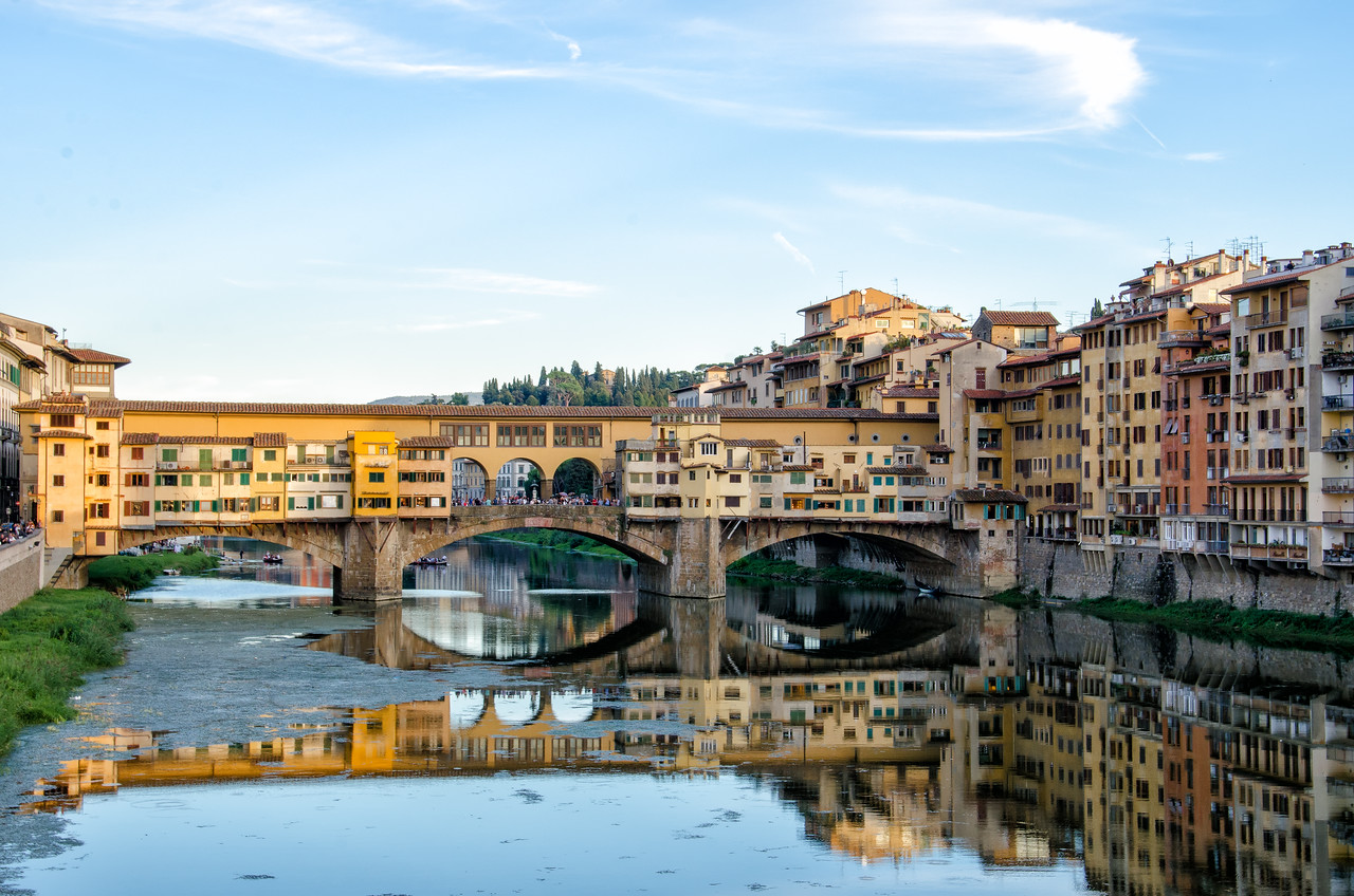 Looking at Ponte Vecchio, a famous bridge lined with gold and silver shops.