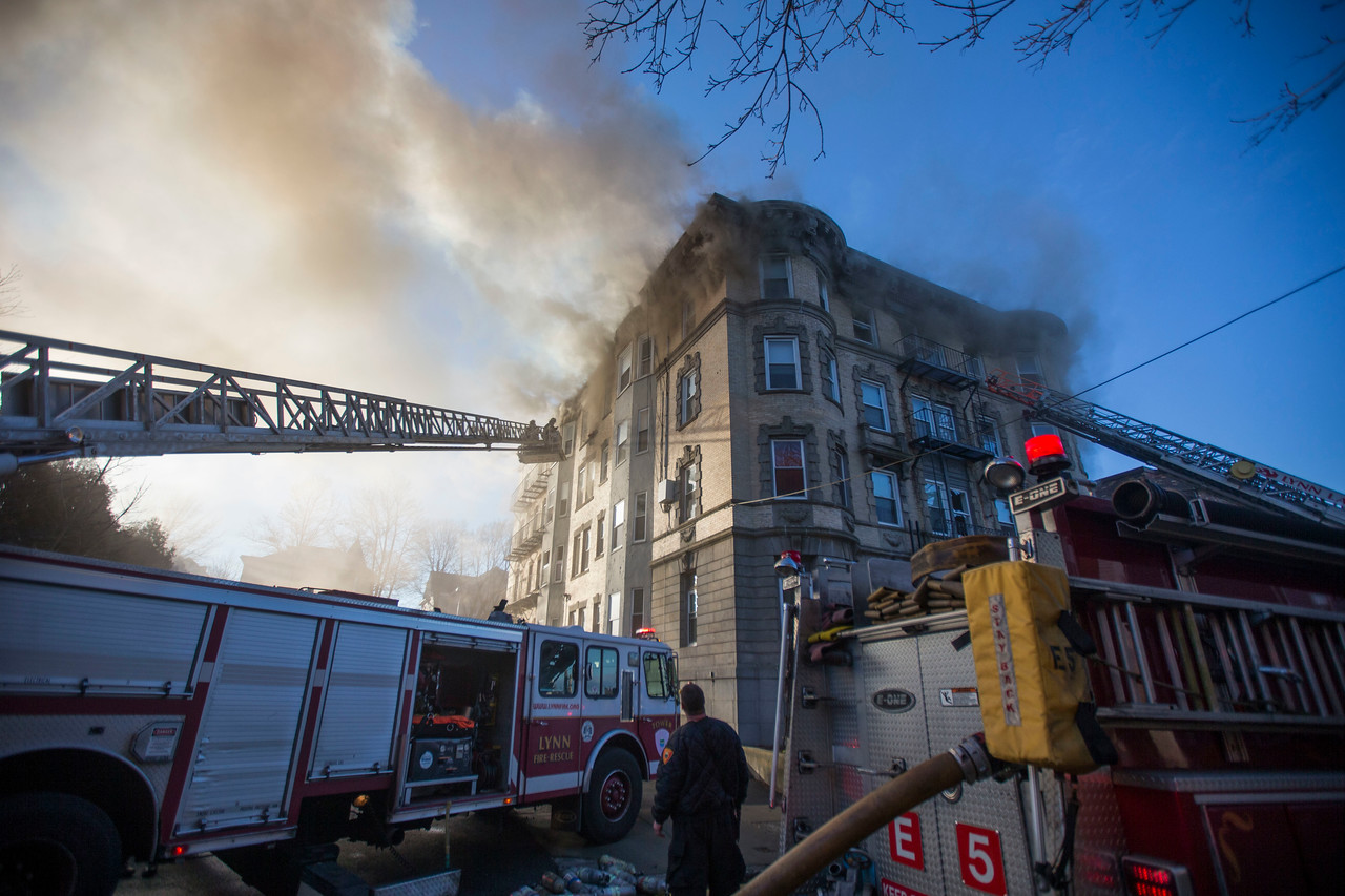 Firefighters work at the scene of a 5-alarm fire at 22 West Baltimore St. in Lynn on Sunday, January 1, 2017. (Scott Eisen/The Item)