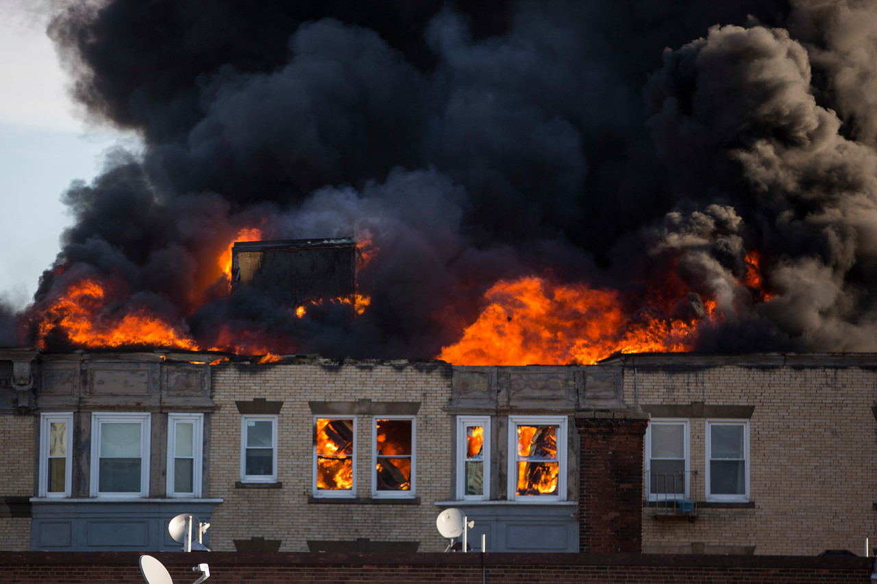 Heavy fire and smoke come from 22 West Baltimore St. at the scene of a 5-alarm fire in Lynn on Sunday, January 1, 2017. (Scott Eisen/The Item)