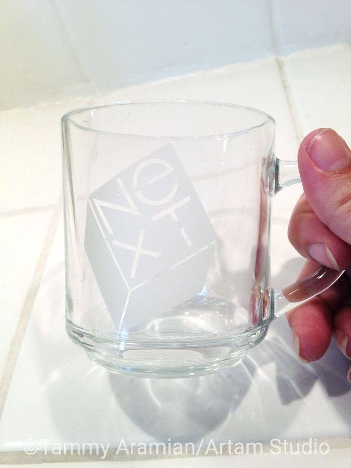 "NeXT clear glass mug (although not strictly Apple, NeXT was born from it and later merged with it) with etched NeXT logo on one side. 3.5"" high, 3"" diameter. Flawless and beautiful! The only other place I have seen one is IN A MUSEUM. - $150"