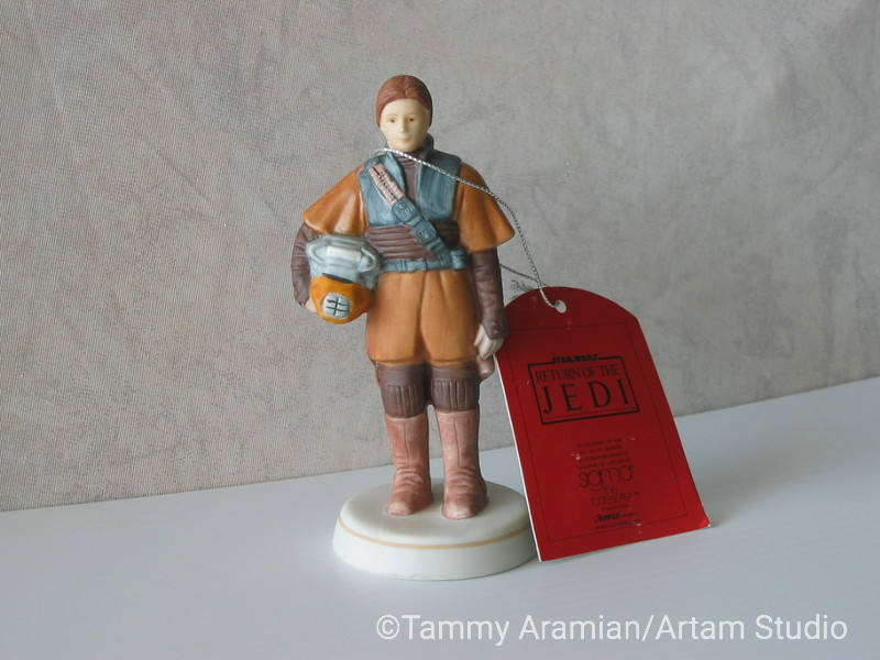 """Sigma 1983 5.5"""" tall ceramic bisque hand-painted figurine of Leia in Boushh disguise with original hang tag. Return of the Jedi branded. Never displayed, no chips or crazing. <br /> $300"""