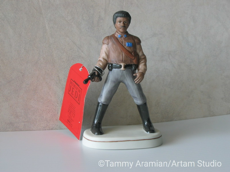 """Sigma 1983 5.5"""" tall ceramic bisque hand-painted figurine of Lando Calrissian with original hang tag. Return of the Jedi branded. Never displayed, no chips or crazing. <br /> $300"""