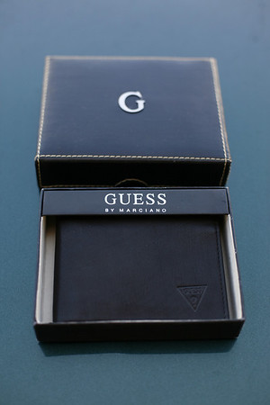 Guess wallet, brand new twenty 5 bucks.  Killer gift/replacement for loved one.