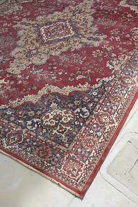Giant, brilliantly colored antique rug... needs cleaning and beating.  see previous photo