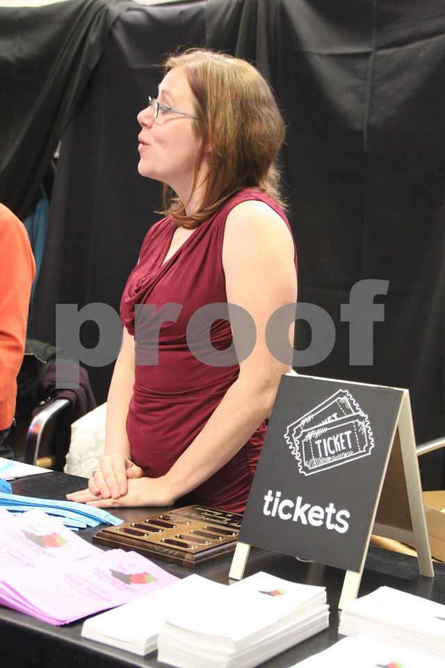 Pictured here is : Jennifer Peterson as she explains how the event  tickets work to people upon their arrival. The event is It's A Chocolate Thing and was held at Fort Frenzy in Fort Dodge on Sunday, November 8, 2015.