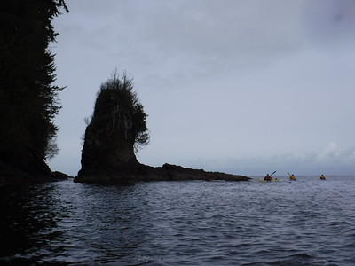 "I thought about squeezing to the left of that rock stack, but figured the ""experienced"" kayakers went around it and they might know something I don't."